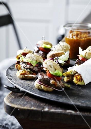 Mini burgers and potato wedges