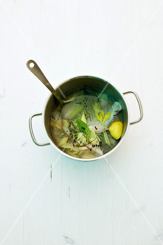 Ingredients for fish stock in a saucepan