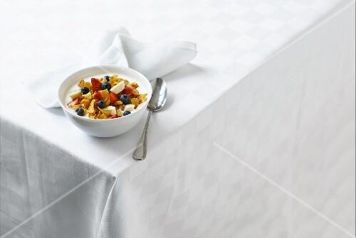 Yogurt with cornflakes and fruit