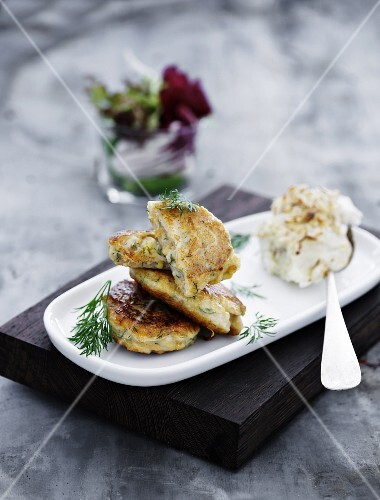 Fish and carrot fritters with nut cream