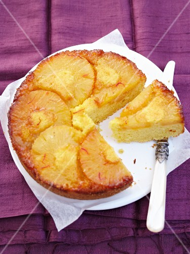 Upside-down pineapple cake with saffron, sliced