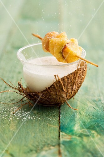 Coconut and yogurt soup served with a fruit skewer