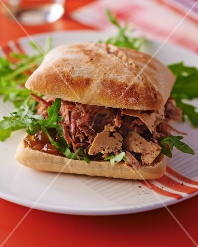 A duck foie gras and duck confit sandwich