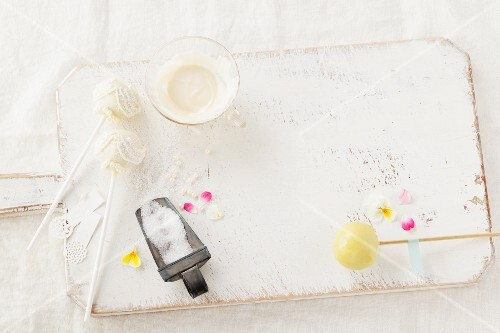 Glaze, edible flowers and sugar pearls for decorating cake pops