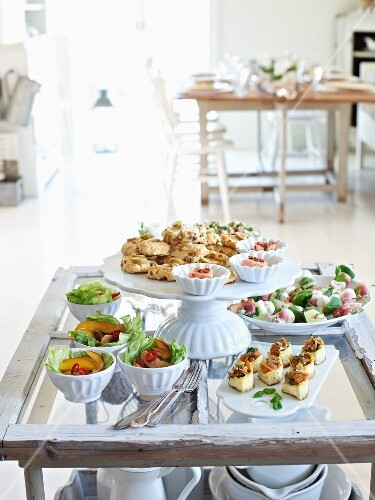 A fingerfood buffet on a rustic glass table