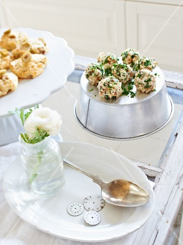Mini olive breads and cheese balls with chopped nuts