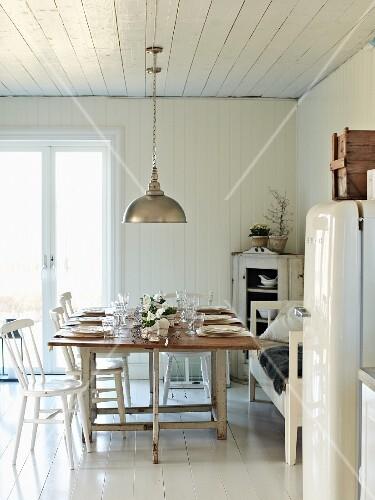 11280668 Set Table In White Kitchen