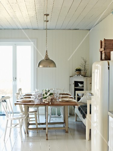 Set table in white kitchen