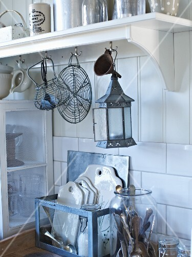Various vintage kitchen utensils in white kitchen