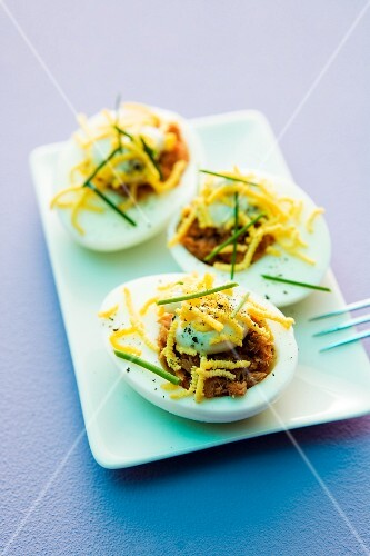 Devilled eggs filled with cheese and chives