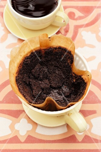 A cup of coffee and a coffee filter