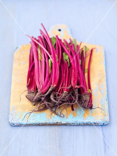 Young beetroot on a chopping board