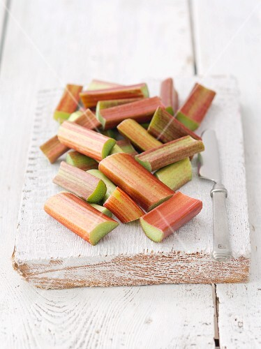 Pieces of rhubarb on a wooden board