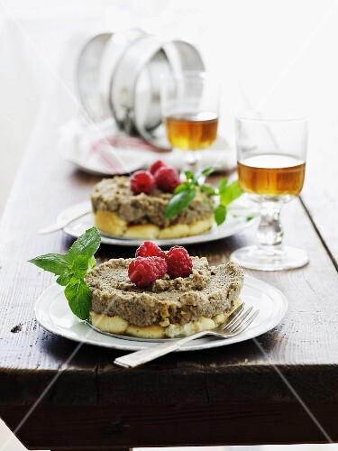 Ricotta-nut parfait on sponge cake with raspberries