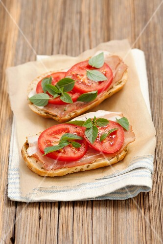 Ciabatta topped with ham and tomatoes