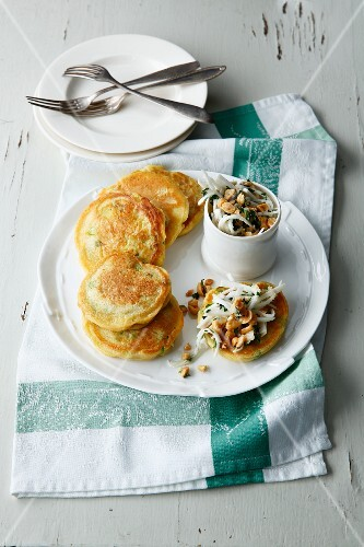 Spring onion pancakes with a turnip and peanut salad