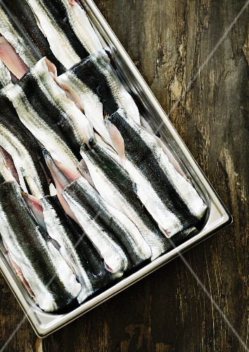 Herring fillets in a metal container