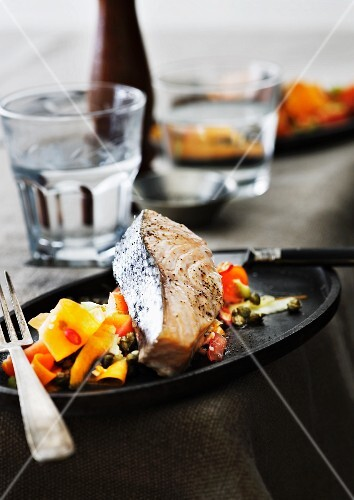 A salmon steak on a carrot salad