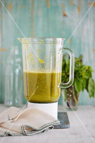 A herb smoothie being made in a mixer