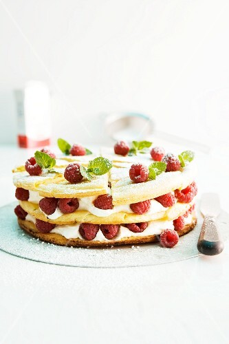 Layer cake with cream and raspberries