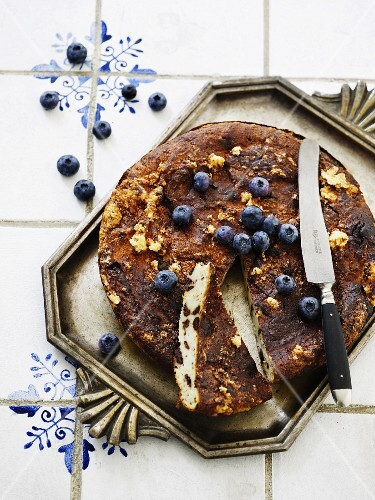 Ricotta cake with chocolate pieces and blueberries