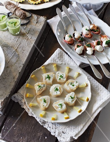 Smoked fish rolls with chive cream, mozzarella with shrimps and avocado shots
