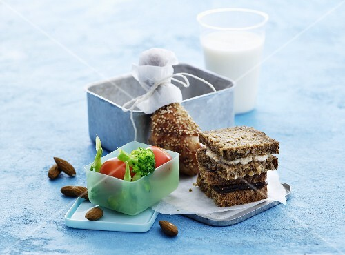 Wholemeal sandwiches, chicken legs, vegetables, almonds and milk for lunch