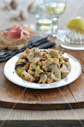 Marinated mushrooms with walnuts and Parma ham