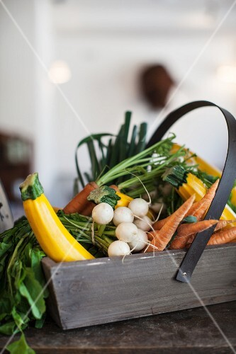 Fresh vegetables in a wooden basket