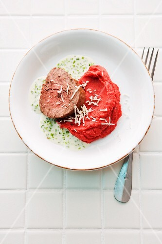 Potato and beetroot purée with a steamed beef fillet