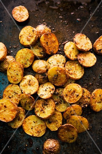Oven roasted potatoes on a baking tray
