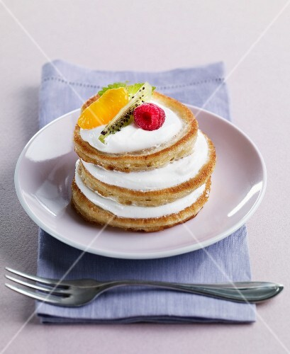 A pancake tower with creamy yoghurt and fruit