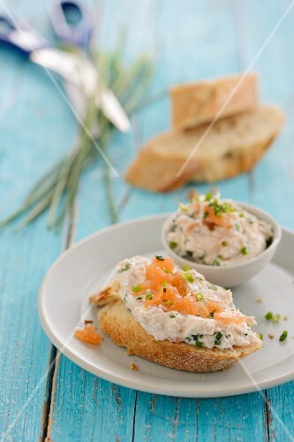 A slice of baguette topped with salmon cream