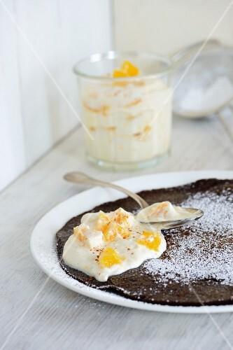 Chocolate and nuts pancakes with orange yoghurt
