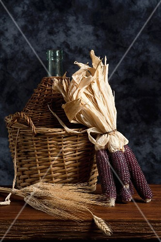 Corn cobs, ears of wheat and a demijohn