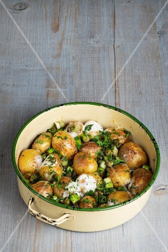 Roasted new potatoes with capers and melted cheese