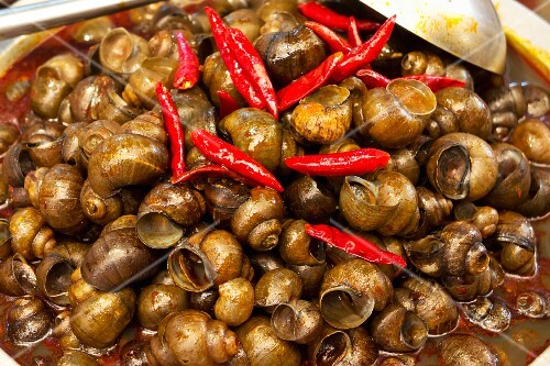 Snails with Chile at a market in Lijiang, China