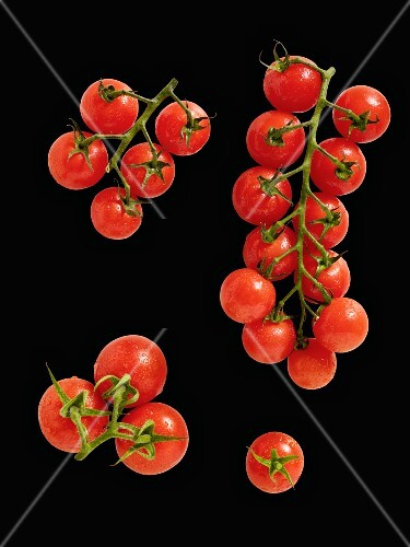 Cherry tomatoes on a black surface