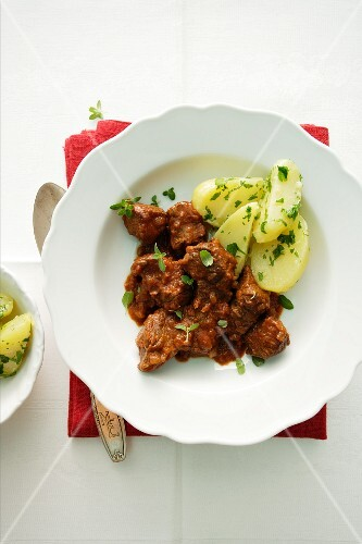 Tender goulash with parsley potatoes