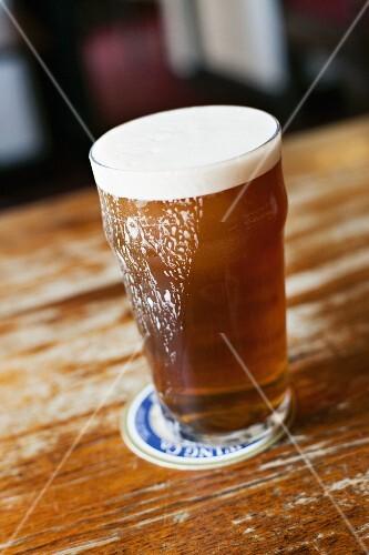 A glass of ale in a pub