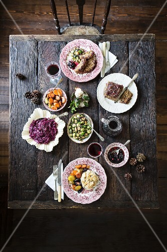 Nut roast with winter vegetables (red cabbage, carrots, Brussels sprouts) for Christmas dinner