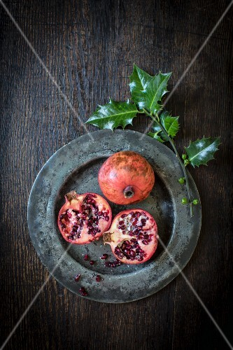 Pomegranates and a sprig of holly
