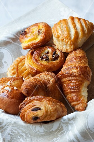 A basket of various Danish pastries