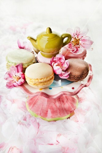 Macaroons on a cake stand with a mini teapot