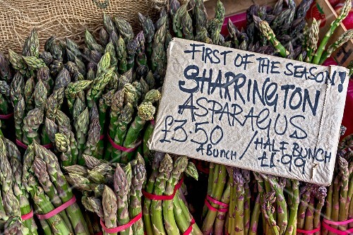 Fresh green asparagus on a market stall