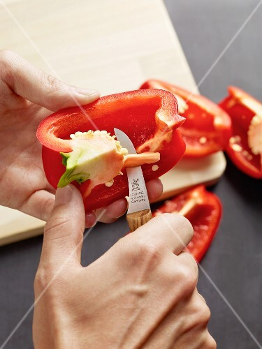 Seeds being removed from a pepper