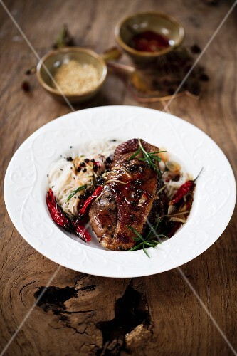 Roast goose with chilli peppers and glass noodles (Asia)