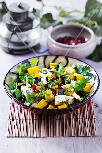 Aubergine and pumpkin salad with blue cheese and pomegranate seeds
