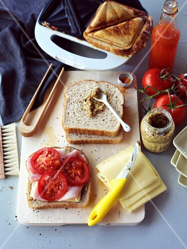 Toasted ham and cheese sandwich with tomatoes and mustard
