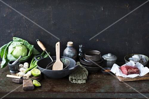 An arrangement of kitchen utensils and ingredients for oriental cuisine